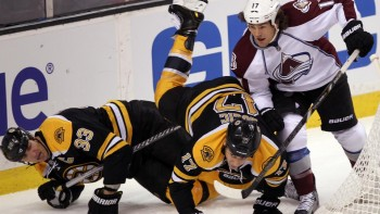 (Boston, MA 10/10/13) Colorado Avalanche right wing Steve Downie causes Boston Bruins defenseman Zdeno Chara and left wing Milan Lucic to go down in the first period of a NHL game against the Colorado Avalanch at the TD Garden on Thursday, October, 10 2013.  Staff Photo By Matt Stone