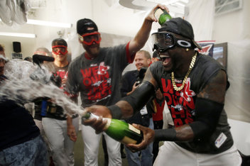 Sep 20, 2013; Boston, MA, USA;  Boston Red Sox player David Ortiz (34) sprays champagne after they won the AL East with a win over the Toronto Blue Jays at Fenway Park. Mandatory Credit: Winslow Townson-USA TODAY Sports